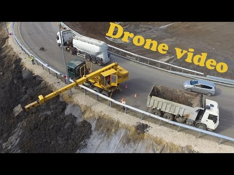 [Drone video] Tatra 815 UDS-114  covering slopes with topsoil