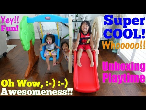 Mini Playground for Babies and Toddlers. Baby Riding a Swing and Toddler Sliding Playtime